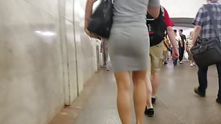 Nice short haired brunette's ass in tight grey dress
