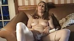 woman masturbating with husband on couch