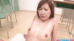 Natsuki Yoshinaga is an asian girl giving blowjob to a group