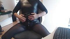 Leather crossdresser strips and masturbates