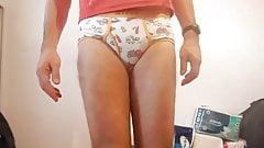 crossdresser in shiny nylon shorts