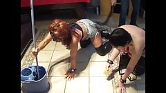 Making his slaves wash the floor while on their knees