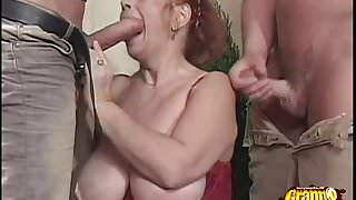 Redhead Granny Gets Lucky With Two!'s Thumb