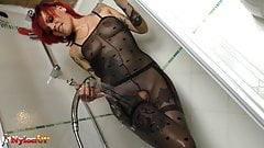 Tattoed redhead in pantyhose masturbates in the shower