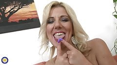 Gorgeous MILF Lucy Angel feeding her pussy