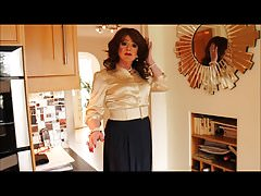 Gold blouse and blue pleated skirt