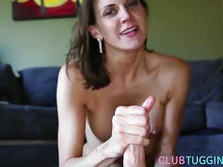 Pierced milf sucks balls while giving handjob