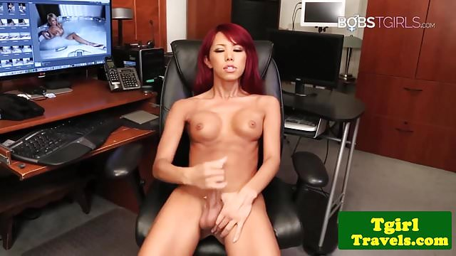 Preview 1 of Heeled redhead ladyboy jerking her hard cock