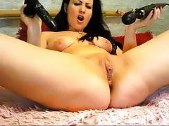 Seductive Brunette Fucks Her Pussy on Cam