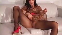 Leggy brunette in pantyhose. JOI