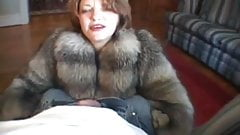 Blow in fox fur coat