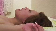 Brunette in sexy lingerie sucks hard cock in bed