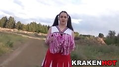 Chubby cheerleader with big natural tits in the field