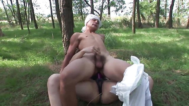 Preview 1 of Brunette wanks partner in grass before making him come with strap-on