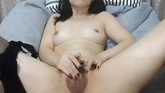 Asian Hairy on a bed