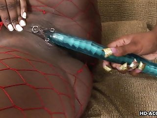 Two ebony lesbians enjoy large dildos