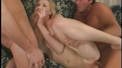 Hot blonde schoolgirl sucks and takes two cocks on couch