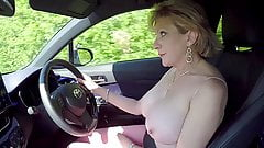 Mature blonde Lady Sonia plays with her tits while driving's Thumb