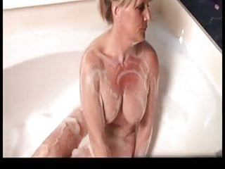 Blonde milf takes a bath and tries out her new toys