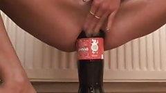 Skinny slut fucking huge bottles in her snatch