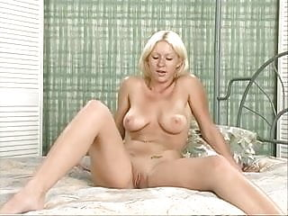 Busty blond coed rubs her wet pink pussy
