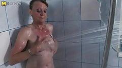 Nice grandmother getting dirty in her bathroom