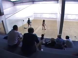 shameless girl playing tennis naked in front of men crowd