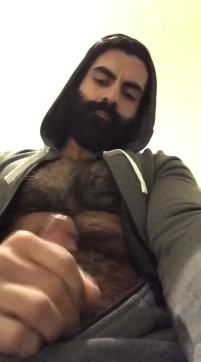 Hairy guy beating off alone