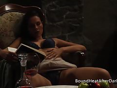 Lesbian Mistress With Erotic Book And Wine In Hands
