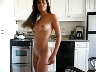 Chick in her kitchen dancing lustily