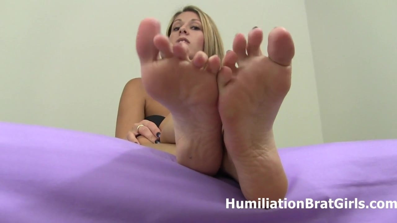 Lick and suck on Nikki Brook's sexy feet