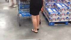 Milf with see through dress bends over to show thong