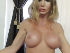 Blonde Milf Shows Off Pec Muscles On Cam