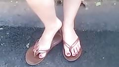 Candid Feet in Flip Flops Painted Toes