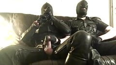 Two guys jerking in full leather