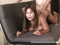 Chubby busty Asian fucks a white cock