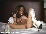 Busty amateur stretches her pussy with two thick dildos