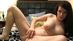 Busty babe playing with her tight pussy