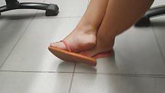 Candid feet play in flip flops faceshot