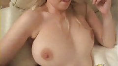 Hot blonde gets naked and shows off her huge tits