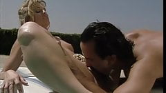 Blonde with nice naturals goes for a big hard cock by the pool