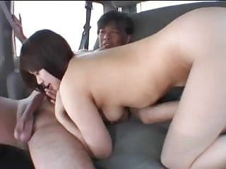Cute young Asian babe fingers pussy through her panties