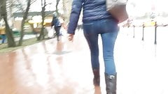 MILF's ass in tight jeans in rainy day