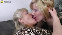 Three old and young lesbians enjoy each other