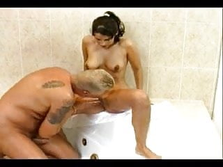 An obedient brunette slut gets banged in the bath and takes a load in the face