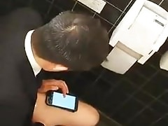 Hot straight business guy jerks off in bathroom
