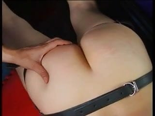 Master teases her crack and spanks her ass