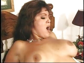 Brunette with big tits sucks dude's cock