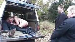 German MILF sucks cock in a car with voyeurs