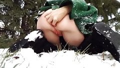 Naughty Milf masturbates in snow